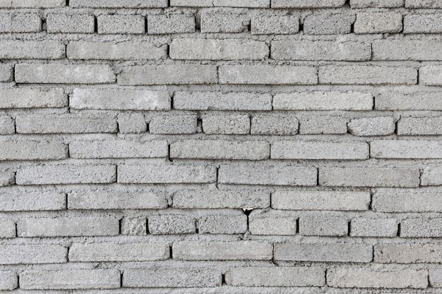 Fondo blanco de la textura de la pared de piedra.