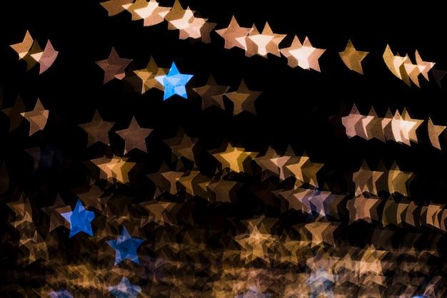 Fondo bokeh con luces en forma de estrellas