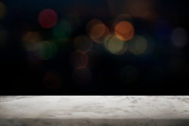 Fondo bokeh negro con piso de mármol blanco