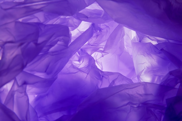 Fondo de la bolsa de plástico. textura violeta. textura de fondo púrpura