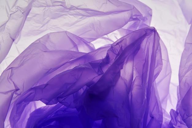 Fondo de la bolsa de plástico. textura violeta.