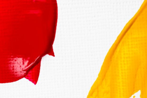 Fondo de borde con textura de frotis de pintura en arte creativo abstracto rojo y azul