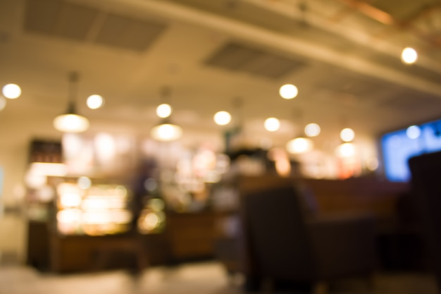 Fondo borroso abstracto de la cafetería - filtro vintage