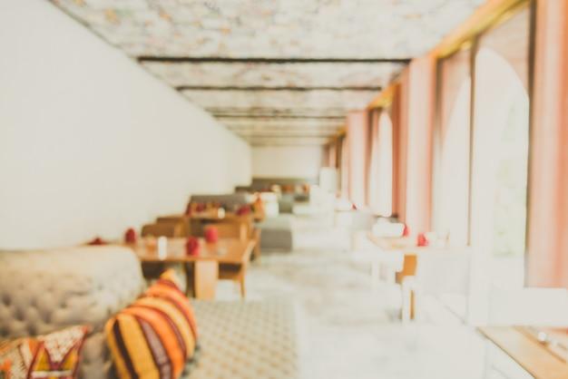Fondo borroso abstracto del restaurante interior - efecto del filtro de la luz del vintage