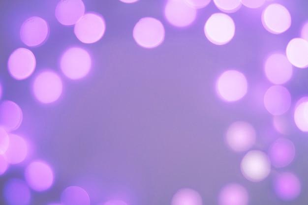 Fondo borroso bokeh festivo espumoso púrpura y azul