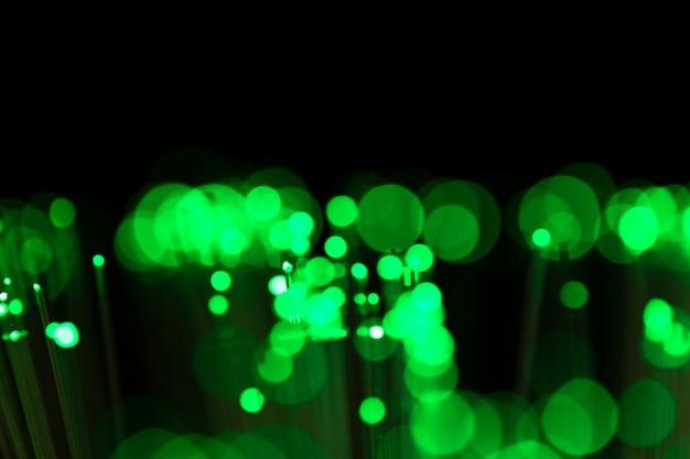 Fondo borroso verde con luces