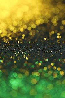 Fondo de brillo dorado y verde con bokeh brillante