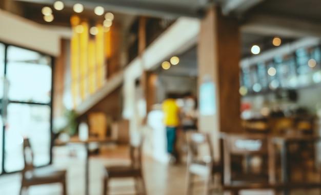 Fondo café borrosa, interior moderno de cafetería con bokeh. efecto de filtro vintage