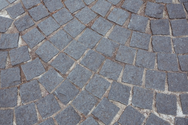 Fondo del camino de piedra del adoquín