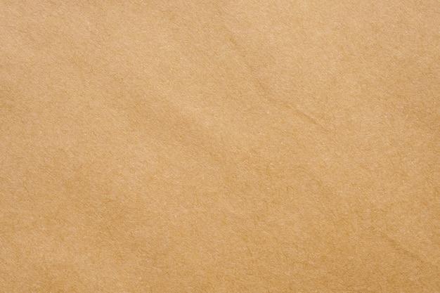 Fondo de cartón de textura de hoja de kraft reciclada de papel marrón