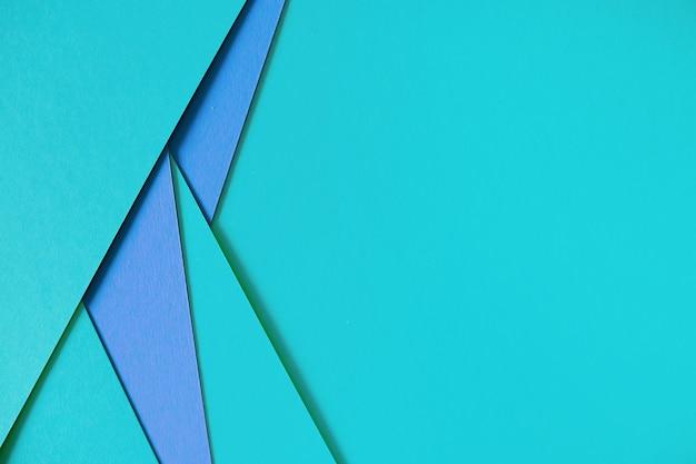 Fondo de cartulina de composición geométrica azul con copyspace