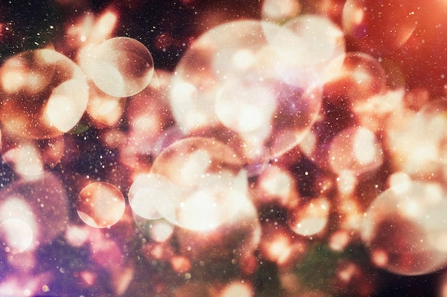 Fondo de celebración con luces doradas desenfocadas para navidad, año nuevo, vacaciones, fiesta