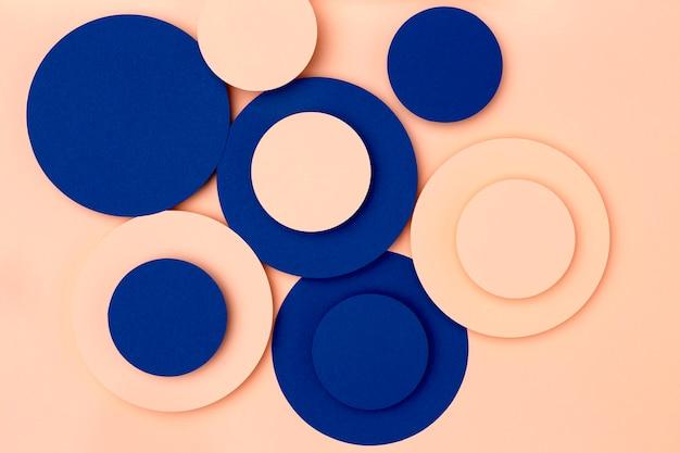 Fondo de círculos de papel azul y melocotón