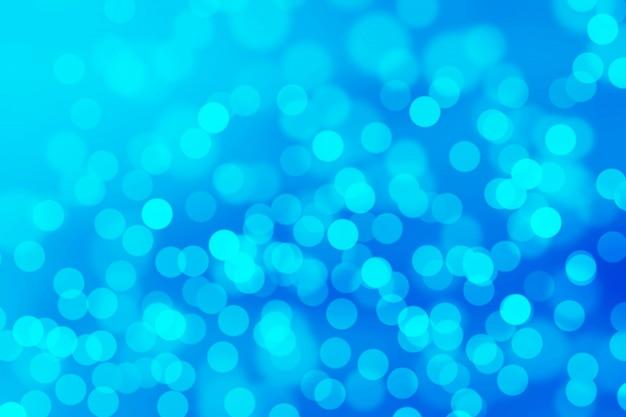 Fondo de color azul bokeh abstracto