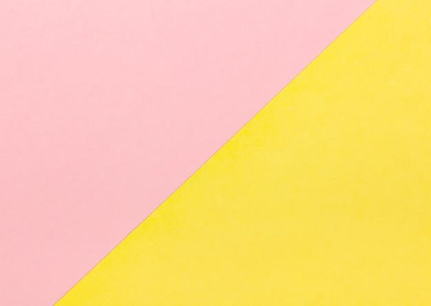 Fondo con color rosa pastel y amarillo.