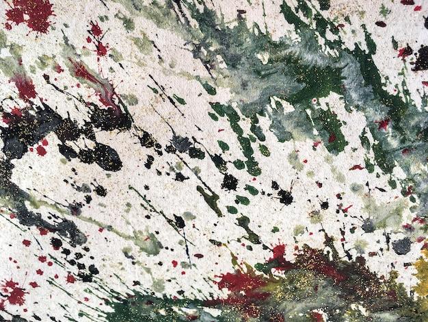 Fondo de coloridas salpicaduras de pintura blanca y verde. fragmento de obra de arte