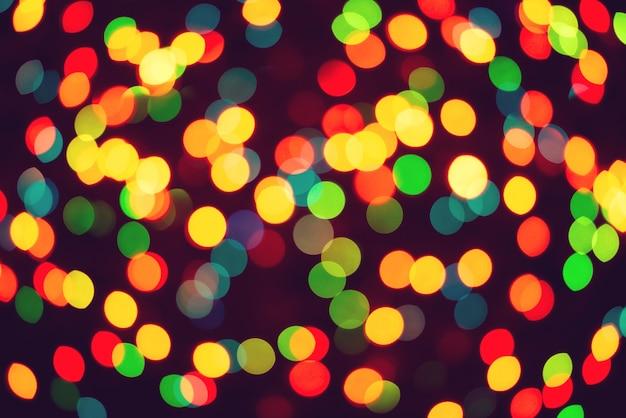 Fondo colorido de luces de guirnalda de navidad