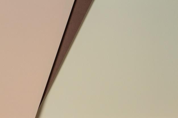 Fondo de composición de geometría de papeles de color abstracto con tonos amarillos, beige y marrón