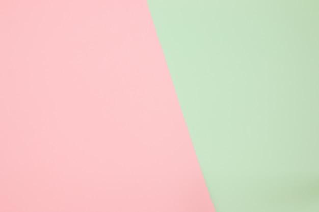 Fondo de composición plana de geometría de papeles de color con tonos pastel rosa y verde