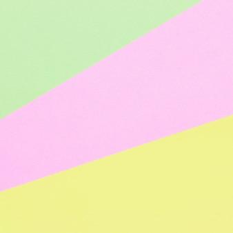 Fondo de composición plana de geometría de papeles de colores con tonos pastel.