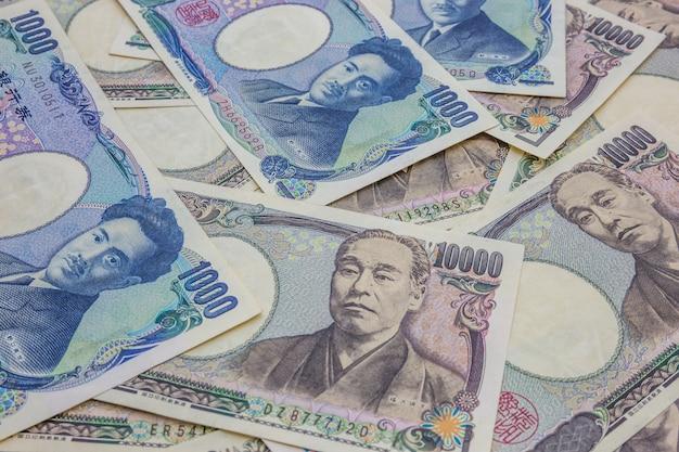 Fondo de concepto de negocios y finanzas de billetes de banco japonés 1,000 y 10,000 yen