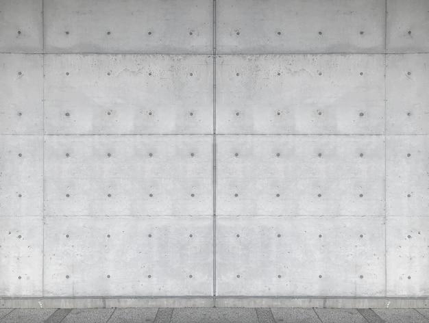 Fondo concreto envejecido de la pared de la cerca del cemento.