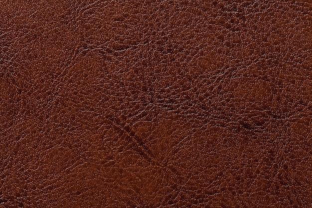 Fondo de cuero marrón oscuro de la textura, primer. fondo de bronce agrietado de la piel de la arruga