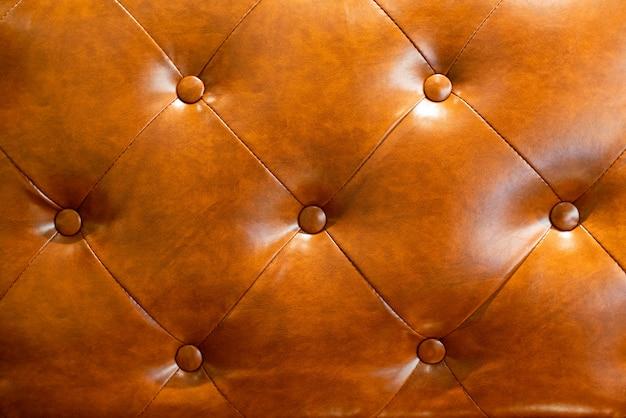 Fondo de cuero marrón de la textura del sofá.