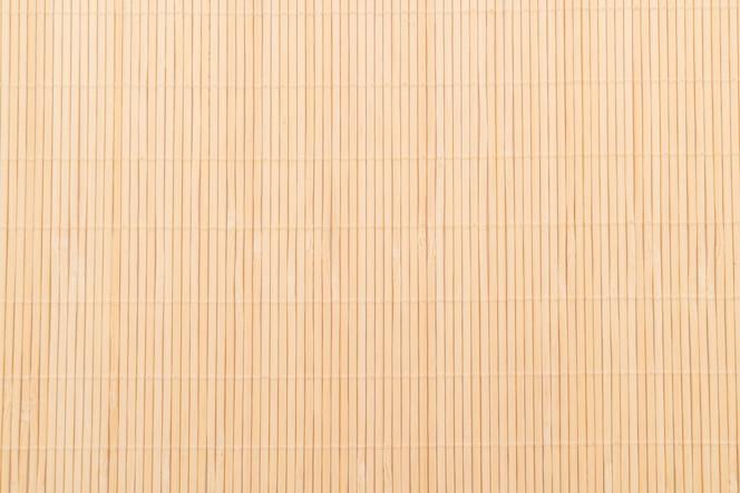 Fondo de la superficie de bambú de la estera