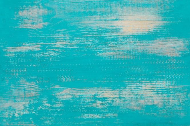 Fondo de madera vieja en color azul claro.