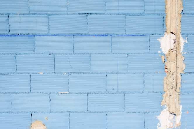 Fondo de pared con textura áspera y envejecida