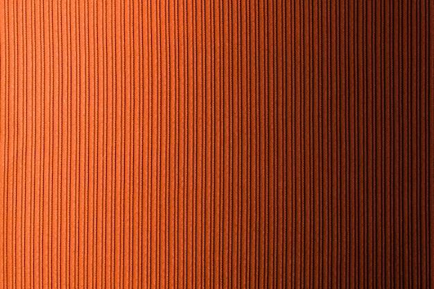 Fondo decorativo de color naranja anaranjado, gradiente horizontal de textura de rayas. fondo de pantalla. arte. diseño.