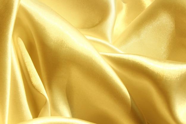 Fondo dorado de la tela
