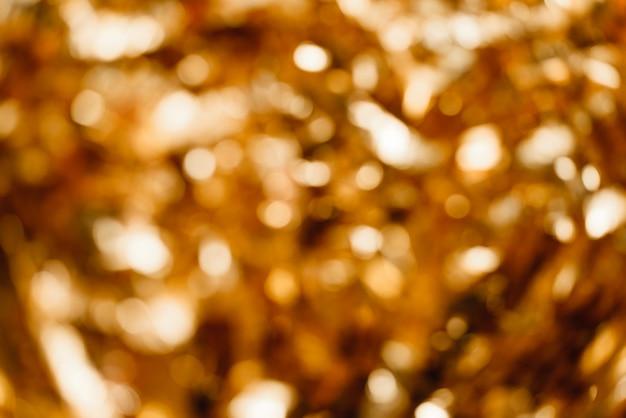 Fondo dorado, fondo abstracto fuera de foco.