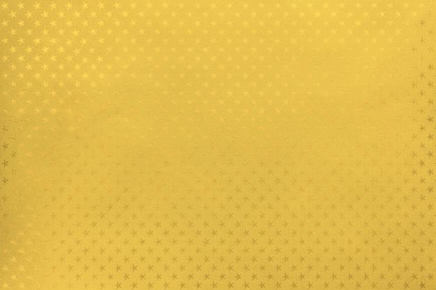 Fondo dorado de papel de aluminio con un patrón de estrellas