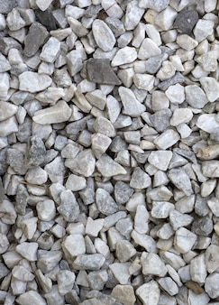 Fondo de escombros o grava, material de construcción. guijarros de grava textura de piedra textura fluida.
