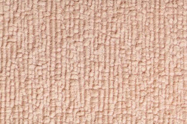Fondo esponjoso marrón claro de tela suave y vellosa. textura de primer plano textil.
