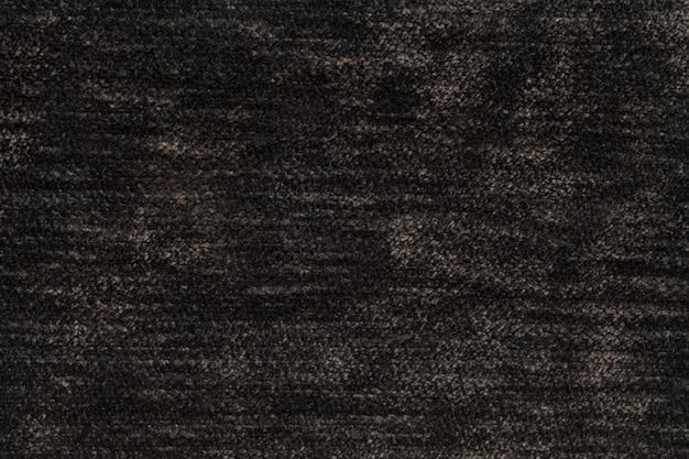 Fondo esponjoso marrón oscuro de tela suave y vellosa, textura de textil de pañal ligero