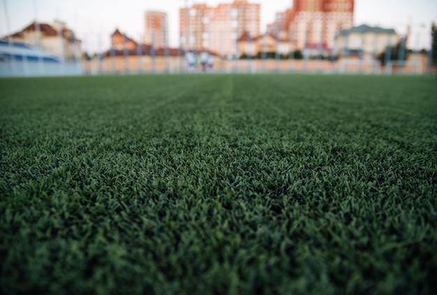 Fondo del estadio borroso, fondo del patio de juegos, fondo de hierba verde, cerca del paisaje