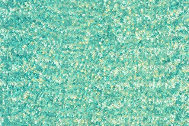 Fondo festivo abstracto con lentejuelas redondas con transición de color. color menta.