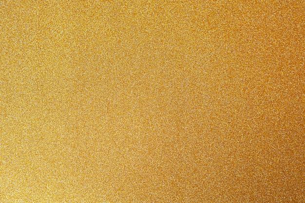 Fondo festivo de oro, primer plano.