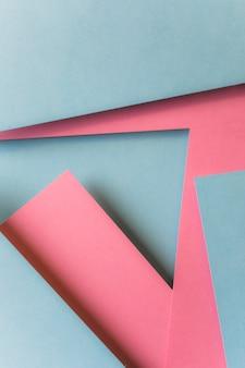 Fondo de forma geométrica de papel rosado y gris abstracto