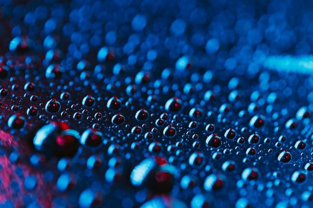 Fondo de gotas de agua brillante azul fresco