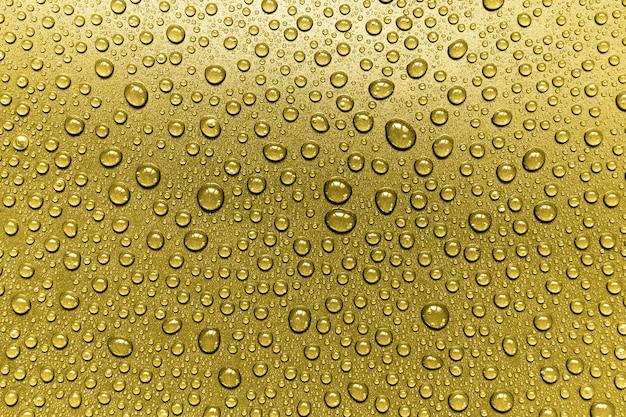 Fondo de gotas de agua dorada