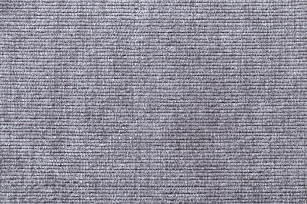 Fondo gris claro de material textil suave. tejido con textura natural.