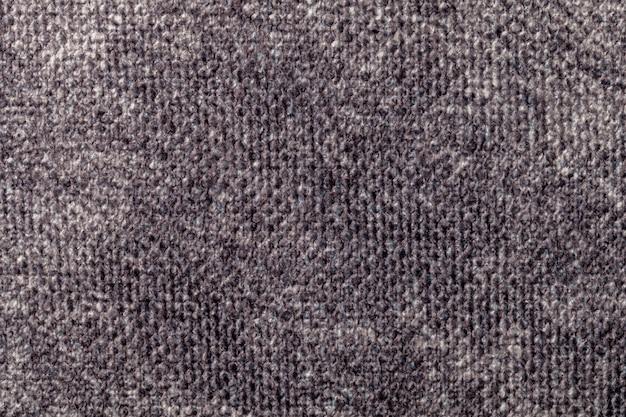 Fondo gris de material textil suave. tejido con textura natural.