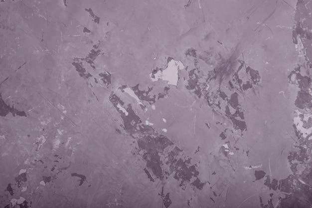 Fondo gris de la textura de la pared del grunge abstracto, entonado.