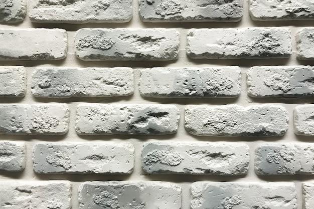 Fondo gris de la textura de la pared de ladrillo. azulejos con espacio de afrontamiento