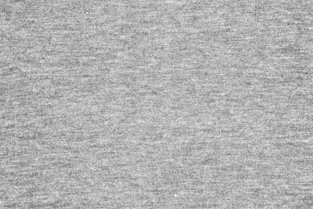 Fondo gris de la textura de la tela del jersey.