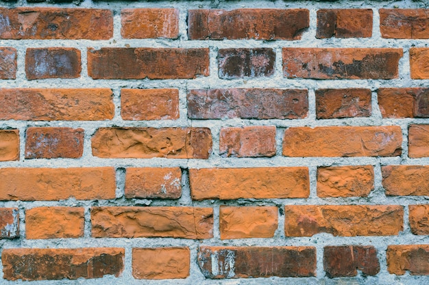Fondo de grunge de textura de pared de ladrillo viejo rojo con esquinas viñeteadas